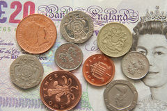 British money. A selection of modern British coins along with a 20 pound note