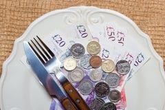 British money on kitchen table, coast of living Stock Photo
