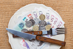 British money on kitchen table, coast of living Royalty Free Stock Image