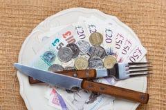 British money on kitchen table, coast of living Royalty Free Stock Image
