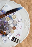 British money on kitchen table, coast of living Royalty Free Stock Photography