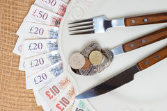 British money on kitchen table, coast of living Royalty Free Stock Photo