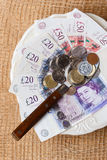 British money on kitchen table, coast of living Stock Photography