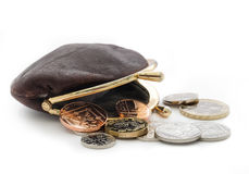 British money in old leather ladies purse. Loose change with an open purse. British coins including the new pound coin introduced in 2017 stock photography
