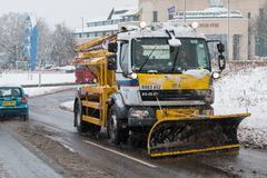 British motorway M1 during snow storm. Hemel Hempstead, UK - December 10, 2017: Snow plough truck clears the snow from the road and spreading salt during snow Stock Photo
