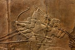 British Museum Lion Hunt Relief. Assyrian alabaster bas-relief carved with the image of the royal Lion Hunt, dated 645 BC. The relief once decorated the palace Stock Image
