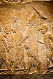 BRITISH MUSEUM - szczegóły od asyryjczyków ściennych pokazuje Egipskich budynków w tle Fotografia Royalty Free