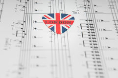 British music. Collage with a guitar pick royalty free stock image