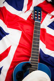 British musicians. Guitar lies on the flag of Britain Royalty Free Stock Photo