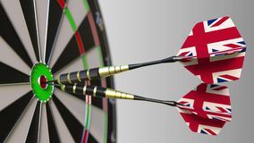 British national achievement. Flags of the United Kingdom on darts hitting bullseye. Conceptual animation. British national achievement. Flags of the United stock footage