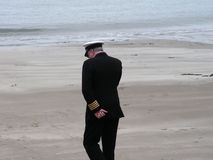 British Navy Uniform. A man on a mobile phone wearing a british merchant navy uniform Royalty Free Stock Photo