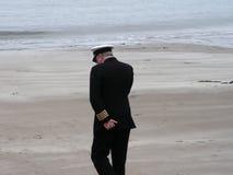 British Navy Uniform. A man on a mobile phone wearing a british merchant navy uniform Royalty Free Stock Photo
