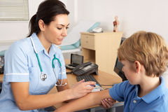 British nurse giving injection to child Royalty Free Stock Photos