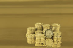 British one pound coins. On gold background Stock Images