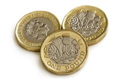 British One Pound Coins Isolated on White. New British one pound coins, isolated on white background royalty free stock image