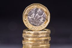 British One Pound Coins. A pile of British one Pound coins Stock Photography
