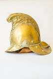 British Other Ranks Merryweather Brass Fire Helmet, side view. British Other Ranks Merryweather Brass Fire Helmet, used during the blitz, Second World War, with Stock Photography