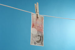 British Paper Currency On Clothesline Royalty Free Stock Photo