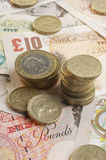 British paper currency and coins Stock Photo