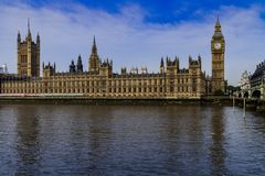 British parliament accross the Thames river stock images