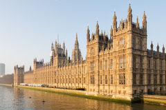 British Parliament. Beautifully lit by the early morning sun at dawn, the British Parliament westminster at full glory on the side of river Thames in London, UK Royalty Free Stock Photography