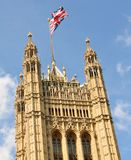 British Parliament. Union Jack flag waves on top of the British Parliament Royalty Free Stock Images