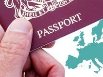 British passport. Male hand holding British 10 year Passport stock photo