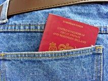 British passport in back pocket Stock Photo