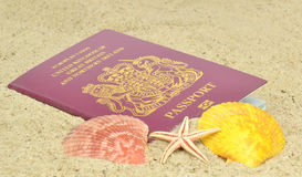 A British passport on the beach Royalty Free Stock Photos