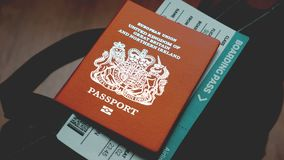 Britain passport and boarding pass on bag Stock Images