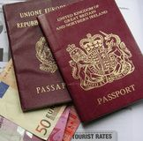 british passport and euro. Above a British and an Italain   passport for the  eurozone, Swiss and Italian money, euro notes and table of tourist rates for Stock Photo