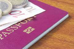 British passport with Euro coins Royalty Free Stock Photo