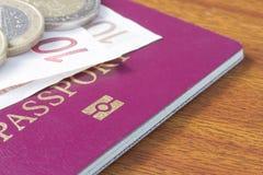 British passport with Euro coins Royalty Free Stock Photo