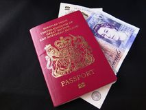 British Passport and money. British and european passport with english cash currency inside Stock Photos
