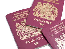 British Passports. New format British Passports with the biometric data included (indicated by the logo at the bottom of each passport stock image