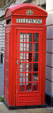 British Phone Booth. A iconic red British phone booth in London Stock Photography