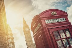 British Phone Booth with Big Ben in London, United Kingdom. Traditional red phone booth with big ben at london on a summer day. ideal for websites and magazines Royalty Free Stock Photography