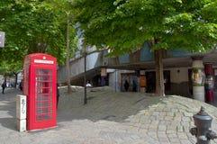 British phone booth near Hundertwasser House in Vienna Stock Photography