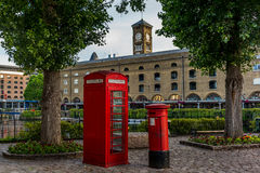 British phone booth in a park in London  Stock Photo