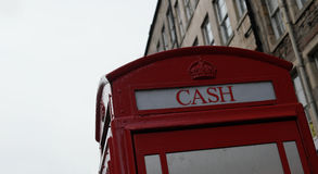 British Phone Booth with writing cash in Edinburgh, Scotland. Top of the British Phone Booth with writing cash in Edinburgh, Scotland Royalty Free Stock Photography