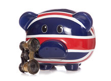 British piggy bank with opera glasses Stock Photos