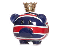 British piggy bank wearing a crown Royalty Free Stock Image