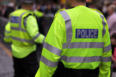 British police. Police in hi-visibility jackets policing crowd control at a UK event Royalty Free Stock Photos