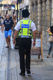 British police man. ('bobby') patrolling the street Stock Photography