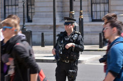 British police man. LONDON - MAY 12 2015:British counter terror police man on guard duty.Since Jan 2015 Police across Britain have been put on high alert and stock photos