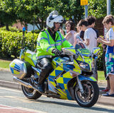 British Police Office and Motorbike. A British police officer riding a police motorcycle Stock Photography