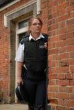 British Police Officer. Female UK Police officer in urban street Stock Image