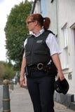 British Police Officer. Female UK Police officer in urban street Stock Photo