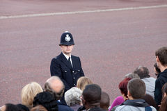British policeman observes crowd. LONDON - JUNE 11: British policeman observes the crowd of spectators during the Trooping the Color ceremony in London, England Royalty Free Stock Photos