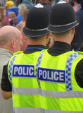 British policemen watching crowd Royalty Free Stock Photo